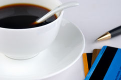 Coffee, credit cards and pen. A cup of coffee and a ball pen with credit cards, means drinking, working, signature and relax Royalty Free Stock Image
