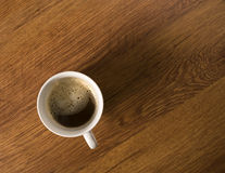 Coffee with crema in white mug on wooden desktop, Stock Photos