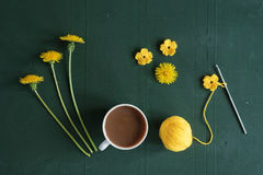 Coffee, crocheting and dandelions Stock Photos