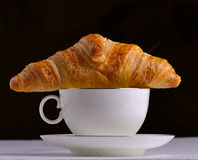 Coffee and a croissant Stock Images