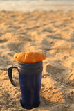 Coffee and croissant on the beach. Breakfast on the beach of the Black Sea coffee and croissant Royalty Free Stock Images