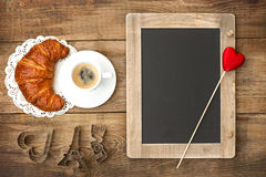 Coffee with croissant, blackboard and heart decora Royalty Free Stock Photography