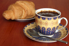 Coffee and croissant. Breakfast with cup of black coffee and croissant Stock Photo