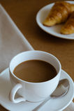 Coffee and Croissant for Breakfast. Cup of Coffee and Croissant are easy meal for breakfast time Stock Photo