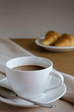 Coffee and Croissant for Breakfast. Cup of Coffee and Croissant are easy meal for breakfast time Royalty Free Stock Photos