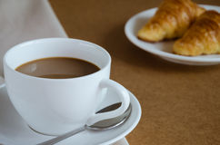 Coffee and Croissant for Breakfast. Cup of Coffee and Croissant are easy meal for breakfast time Stock Image