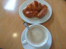 Coffee and croissant for breakfast Royalty Free Stock Photos