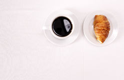Coffee and croissant for breakfast Royalty Free Stock Images