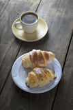 Coffee and croissant for breakfast Stock Photo