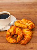 Coffee and croissant for breakfast on rustic wooden table, top view Stock Photos