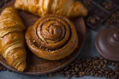 Coffee croissant chocolate breakfast arranged on a gray stone background top view. Photo in a low key. Breakfast, croissants with coffee on a gray background royalty free stock image