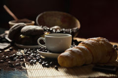 Coffee and croissant. Cup of coffee and a croissant royalty free stock images