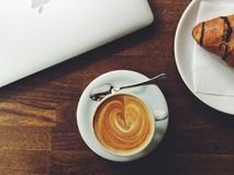 Coffee and croissant with laptop Stock Photos