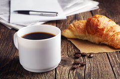 Coffee, croissant and newspaper Stock Photography