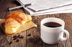 Coffee, croissant and newspaper Stock Image