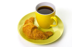Coffee with Croissant. Simple scene with a coffee mug and a croissant on a plate Royalty Free Stock Photos