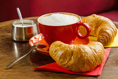 Coffee with croissant and sugar bowl. A simple and tasty composition of a french breakfast in a cafe Stock Images