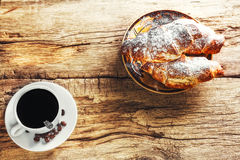 Coffee and croissant. On wooden background Royalty Free Stock Image
