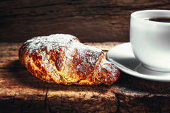 Coffee and croissant. On wooden background Stock Image
