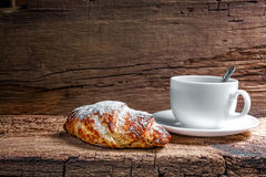 Coffee and croissant. On wooden background Royalty Free Stock Images