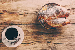 Coffee and croissant. On wooden background Royalty Free Stock Photography