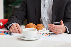 Coffee and croissant at work Royalty Free Stock Photo