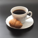 Coffee and croissants. Black background Royalty Free Stock Photos