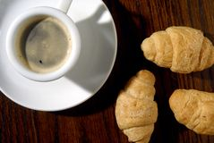 Coffee and croissants. Black coffee cup with croissants Stock Photography