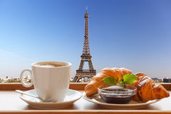 Coffee with croissants against Eiffel Tower in Paris, France Stock Images