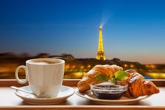 Coffee with croissants against Eiffel Tower in Paris, France Stock Photos