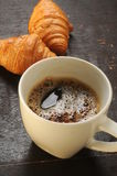 Coffee with croissants background table Royalty Free Stock Photo