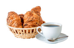 Coffee and croissants in basket isolated on white Royalty Free Stock Images