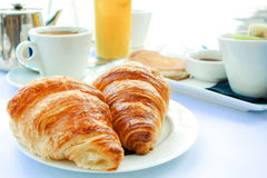 Coffee and croissants Stock Images
