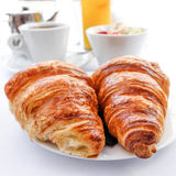 Coffee and croissants Stock Photos
