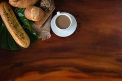 Coffee, croissants, cinnamon rolls and berries breakfast.