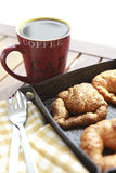 Coffee and croissants closeup. Coffee breakfast with croissant closeup in leather nest Royalty Free Stock Photography
