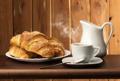 Coffee with croissants Stock Photos