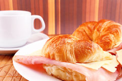 Coffee with croissants with ham and cheese Royalty Free Stock Images