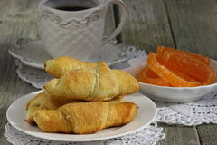 Coffee with croissants. Orange jujube and croissants for breakfast Shallow DOF stock photos