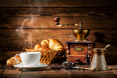 Coffee and croissants on wooden background Stock Images