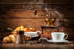 Coffee and croissants on wooden background Stock Photography