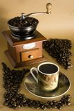 Coffee culture. Grinder coffee, cup of coffee and beans Stock Image