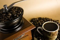 Coffee culture. Grinder coffee, cup of coffee and beans Stock Photography