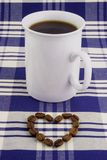 Coffee cup 1. A coffee cup with beans shaped as a heart Stock Photography