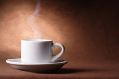 Coffee cup. With steam on vintage background Stock Photos