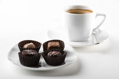 Coffee cup. And assortment of chocolates Stock Photo