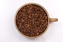 Coffee Cup. Large coffee cup filled with roasted coffee beans on a white background stock photography
