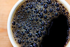 Coffee cup. Black coffee in cup with bubbles Stock Photos