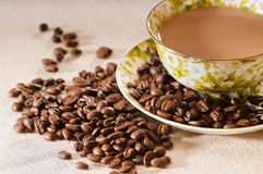 Coffee cup. Roasted coffee beans and a cup full of coffee Stock Image
