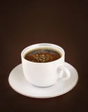 Coffee cup. Cup of coffee on dark background stock image